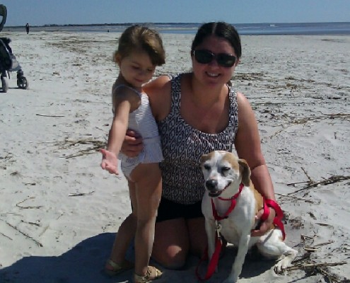 Arena with her family at the beach