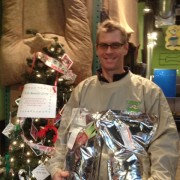 Billy Stalker, IHH employee, with the Angel Tree and some bags of food that were donated.