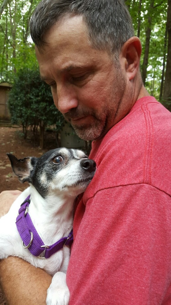 Roxy spending her last few days in the arms of her loving foster daddy, Larry/